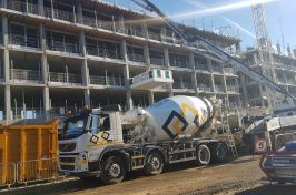 Building being built with concrete truck
